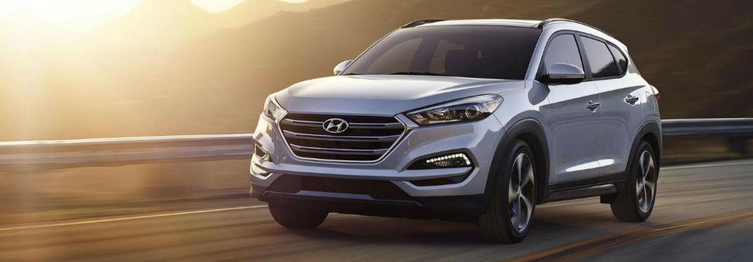 2018 hyundai tucson driving in sunset