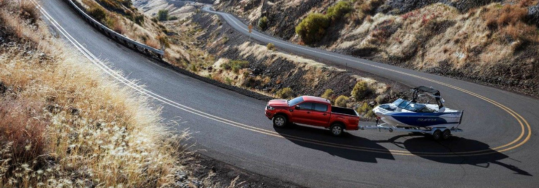 red-2019-Ford-Ranger-towing-boat-up-mountain-road