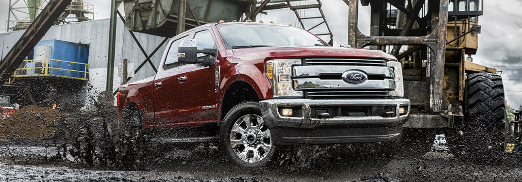 red-2017-Ford-F-250-driving-through-mud-at-work-site