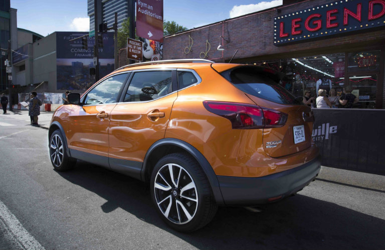 Orange Nissan Rogue Sport On City Street