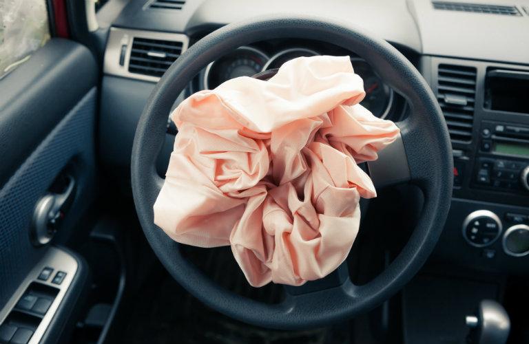 exploded air bag in steering wheel