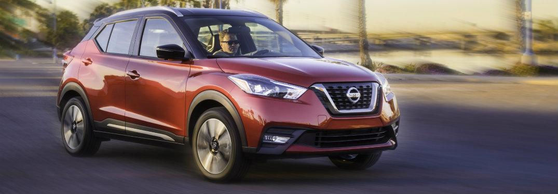 dark orange nissan kicks driving