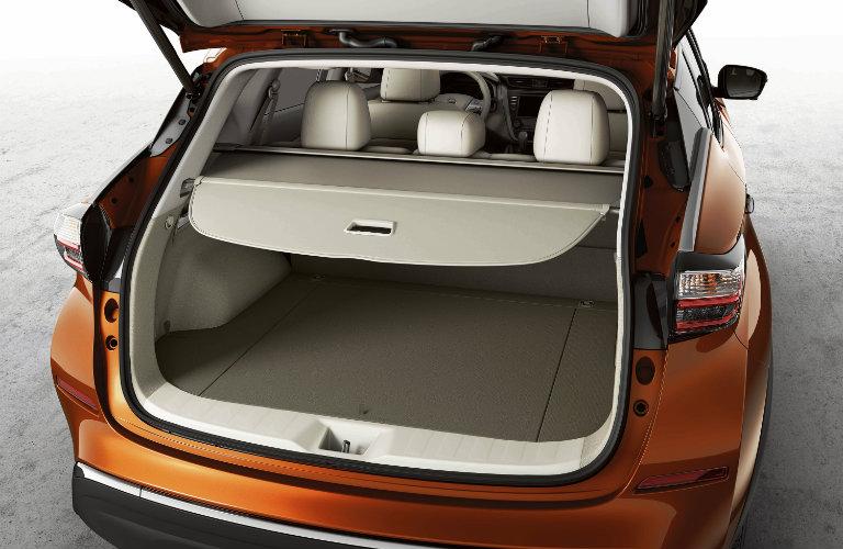 orange nissan murano hatchback open with draw shade