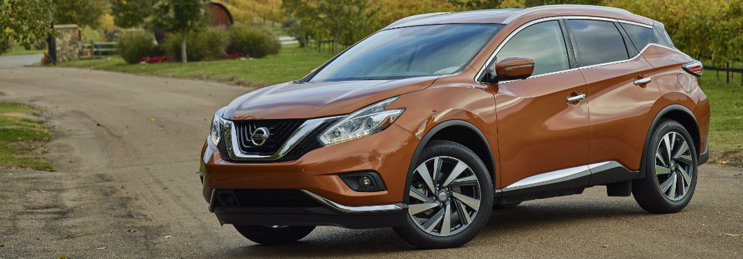 dark orange nissan murano on dirt road