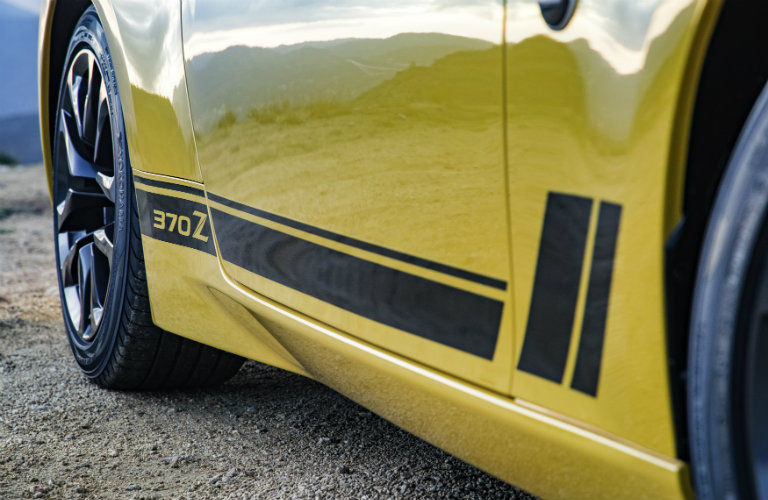 side of yellow nissan 370z