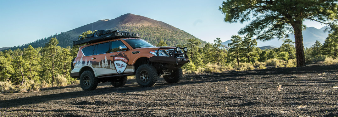 nissan armada mountain patrol on dirt by mountain