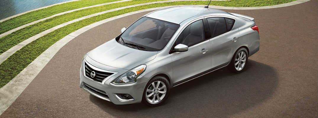 Silver 2018 Nissan Versa parked on waterfront