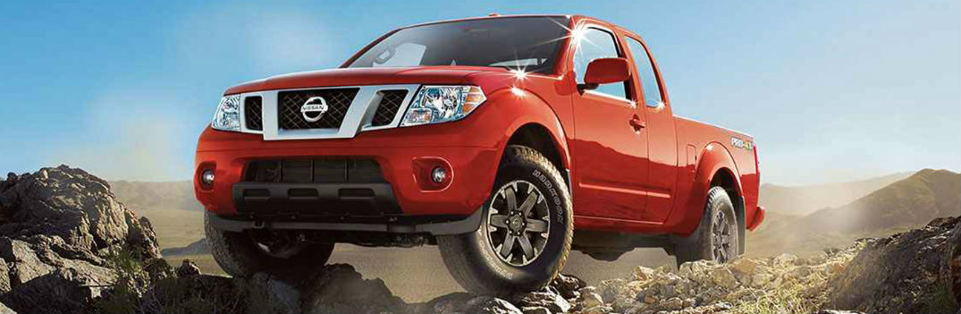 Red Nissan Frontier climbing a mountain