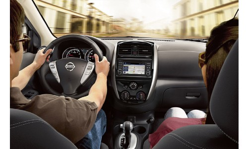 Driver and passenger in Nissan Versa