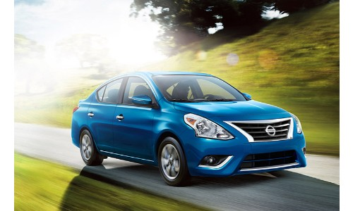 Nissan Versa blue driving on sunny day