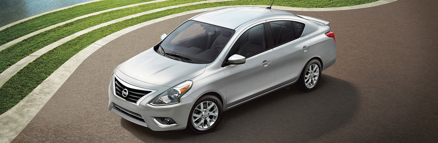 Exterior view of a silver 2019 Nissan Versa parked on fresh pavement