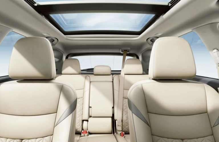 Interior view of the beige rear seating and panoramic moonroof inside a 2019 Nissan Murano