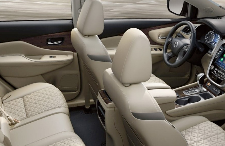 Interior view of the beige seating and black steering wheel inside a 2019 Nissan Murano