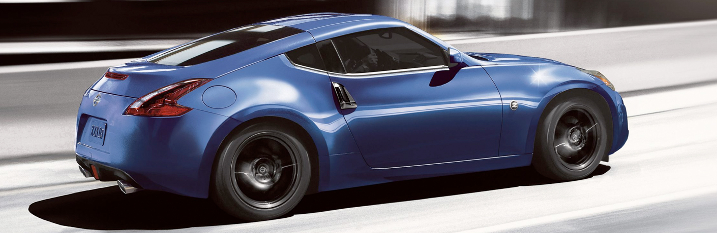 Exterior view of a blue 2019 Nissan 370 Z Driving down the highway