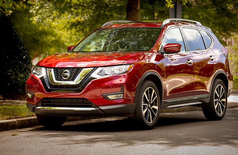 Exterior view of the front of a red 2019 Nissan Rogue