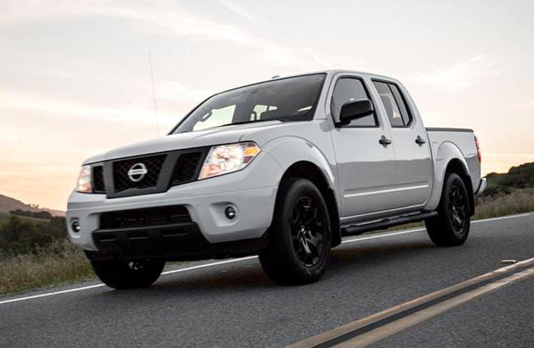 Exterior view of a white 2019 Nissan Frontier