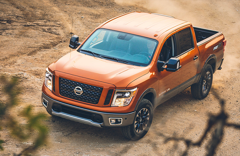 Exterior view of the front of an orange 2019 Nissan TITAN