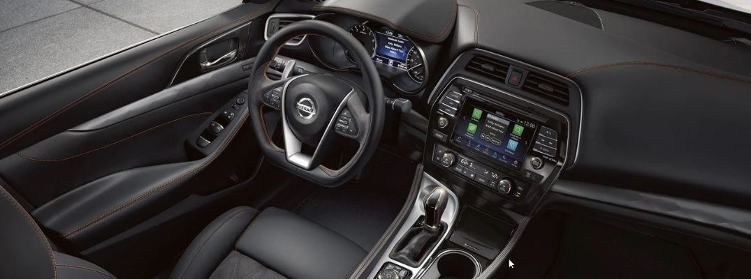 Interior view of the touchscreen and steering wheel inside a 2020 Nissan Maxima