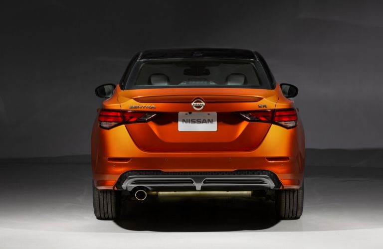 Exterior view of the rear of an orange 2020 Nissan Sentra
