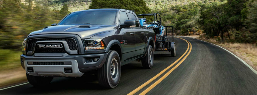 RAM 1500 Towing Trailer Down the Road