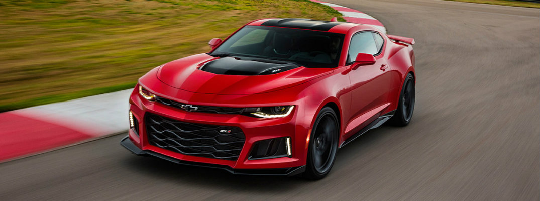 Red 2017 Chevy Camaro driving on a racetrack