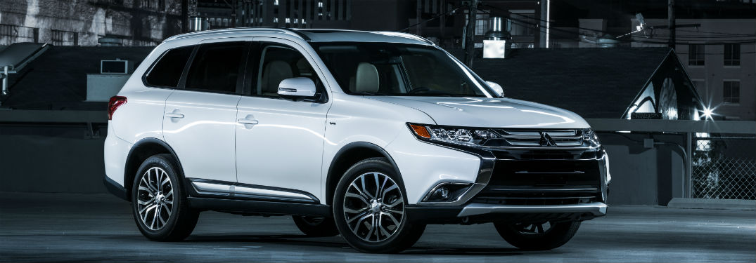 Passenger side exterior view of a white 2018 Mitsubishi Outlander
