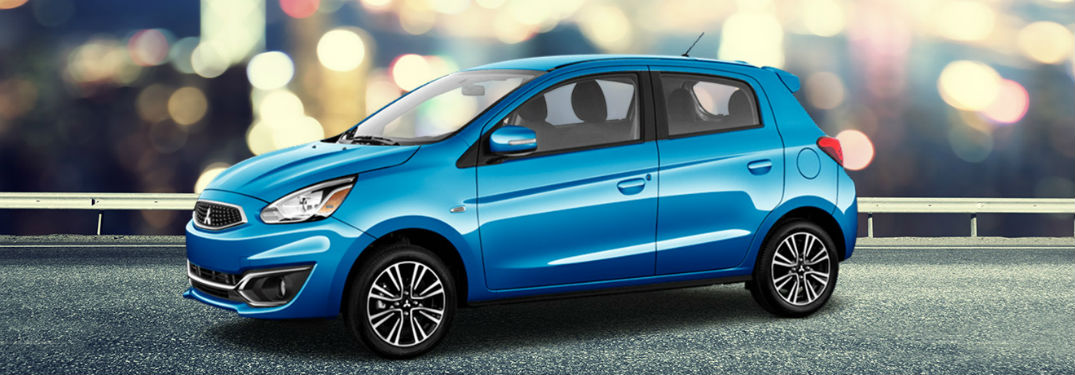 Driver side exterior view of a blue 2018 Mitsubishi Mirage