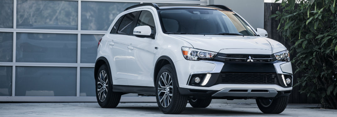 Front exterior view of a white 2018 Mitsubishi Outlander Sport