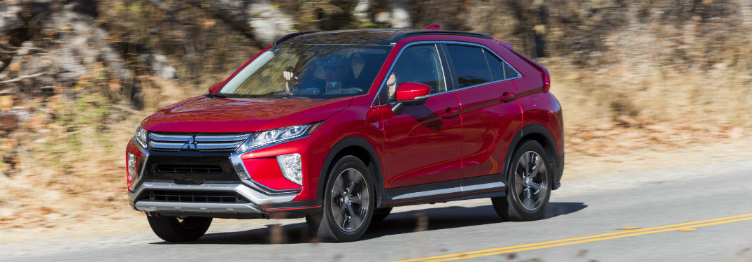 Driver side exterior view of a red 2018 Mitsubishi Eclipse Cross