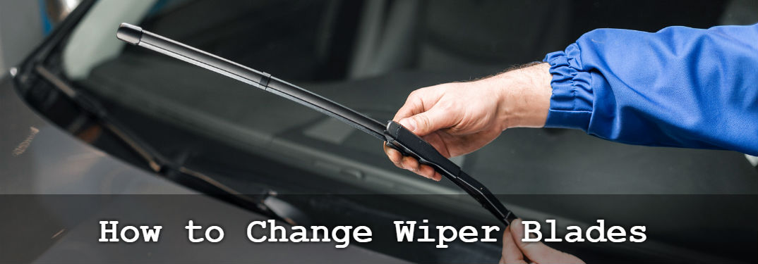How to Change Windshield Wiper Blades with image of a man holding a wiper blade