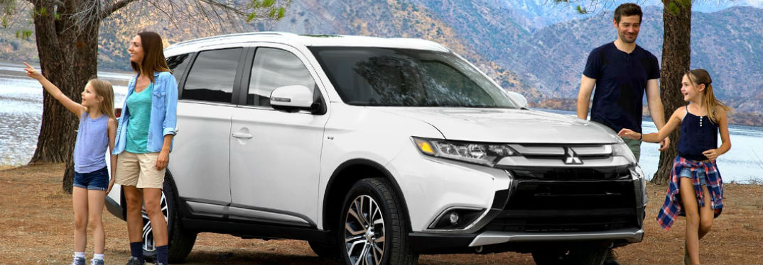 New Mitsubishi Models for Camping with image of a 2018 Mitsubishi Outlander with a family camping