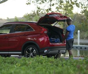 2019 Mitsubishi Eclipse Cross with man accessing cargo area