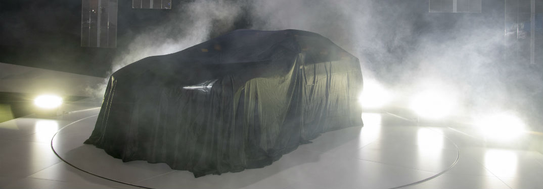 What is the Mitsubishi e-Evolution Concept? with image of the Mitsubishi e-Evolution Concept under a veil