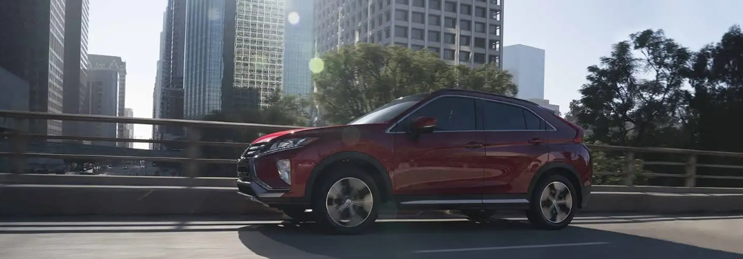 red mitsubishi eclipse cross in the city