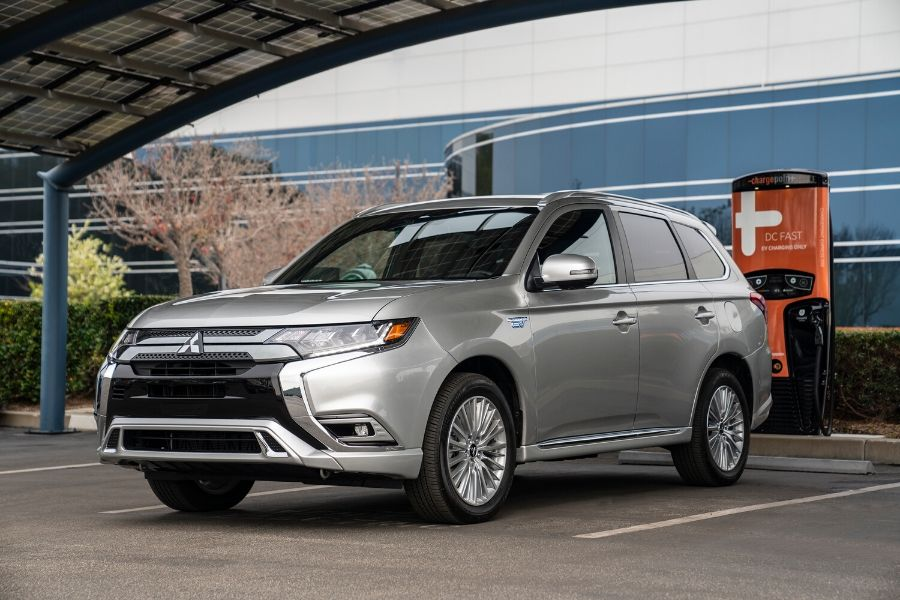 2019 Mitsubishi Outlander PHEV at charging station from exterior front driver side