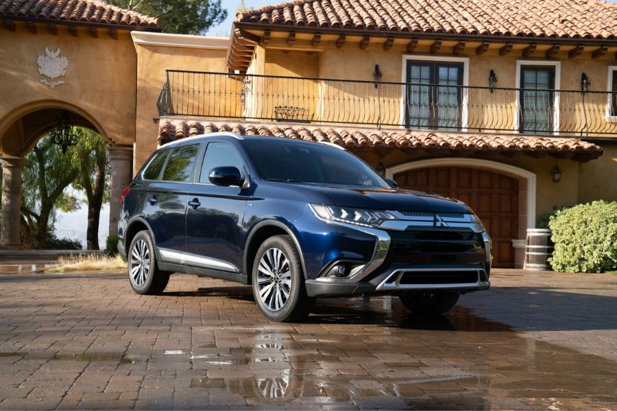 2019 Mitsubishi Outlander in front of house from exterior front passenger side