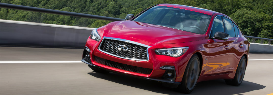 red infiniti q50 driving on highway