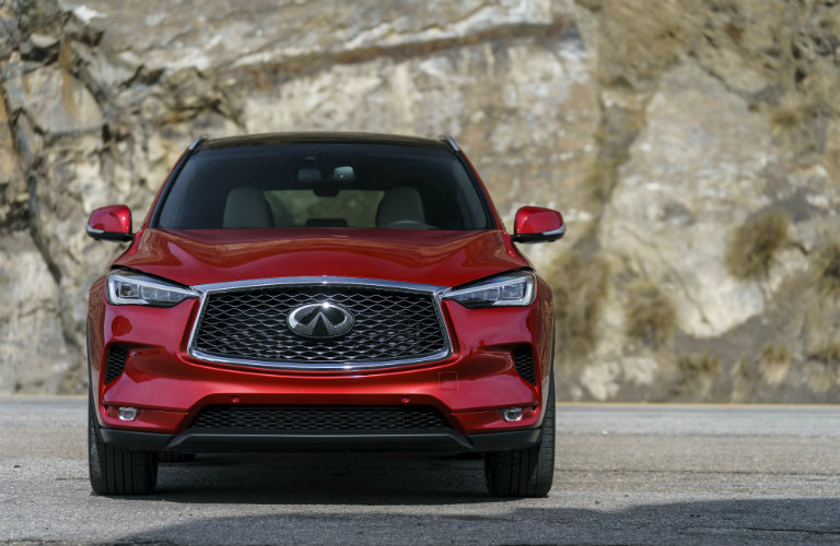 front of red infiniti qx50