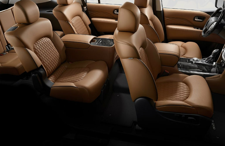 Interior view of the three rows of light brown seating inside a 2019 INFINITI QX80
