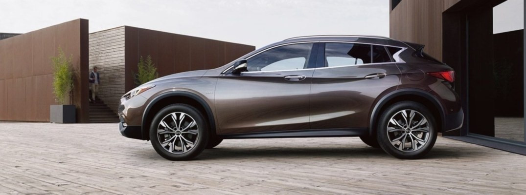 Exterior view of a graphite shadow 2019 INFINITI QX30 parked in a driveway