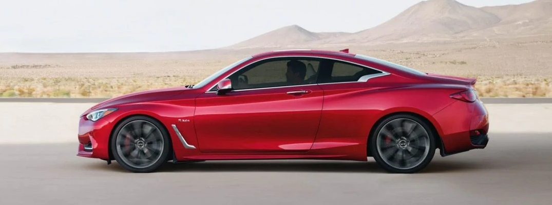 Exterior view of a red 2019 INFINITI Q60 driving down a desert highway