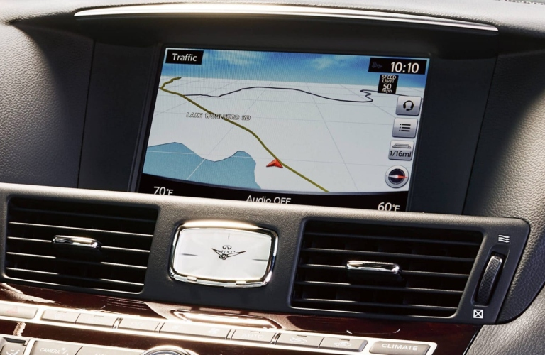 Interior closeup view of the touchscreen utilizing navigation inside a 2019 INFINITI Q70