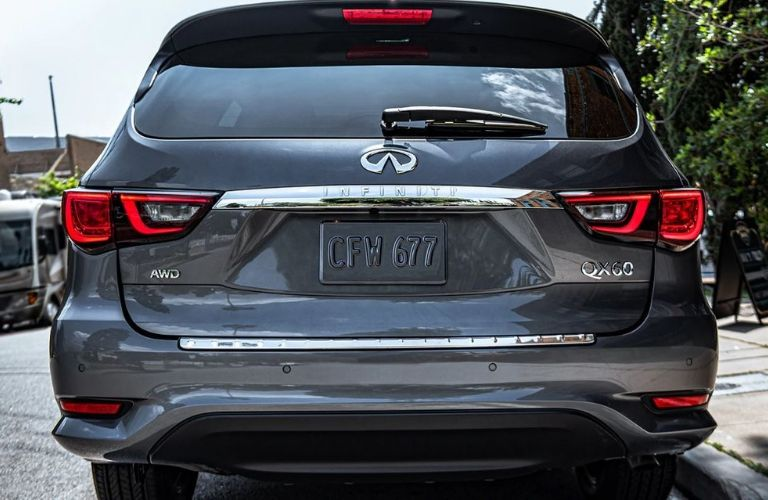 Exterior view of the rear of a gray 2020 INFINITI QX60