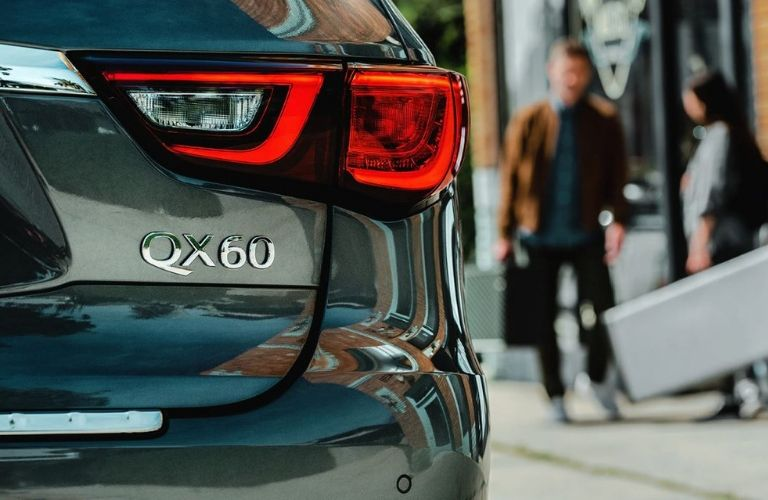 Closeup view of badging on the rear hatch of a gray 2020 INFINITI QX60