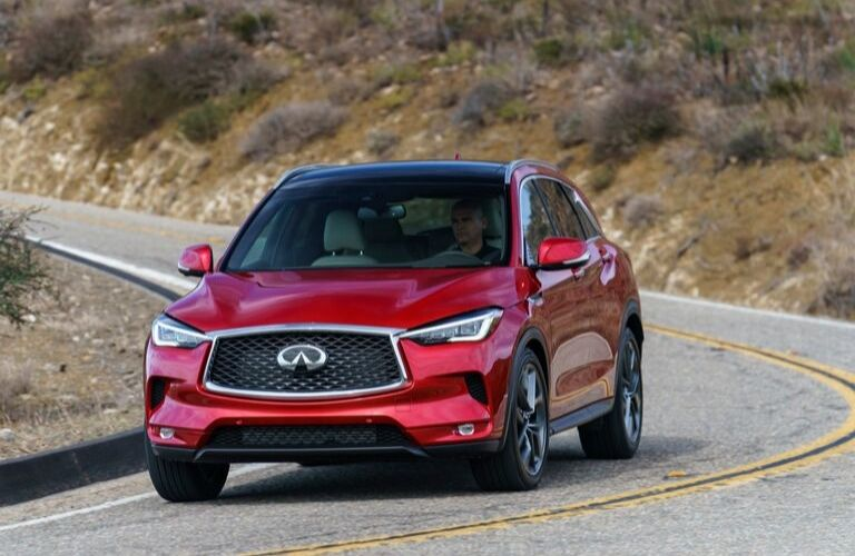 Exterior view of the front of a red 2020 INFINITI QX50