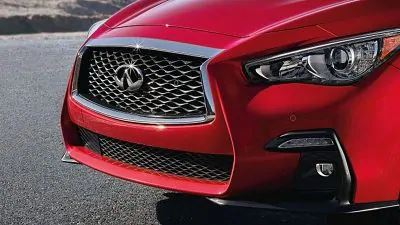 Exterior view of the front Sport Fascias on a red 2020 INFINITI Q50 Red Sport 400
