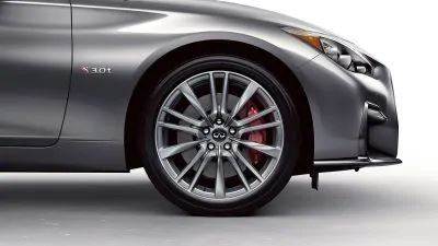 Exterior view of the 19-inch sport-design aluminum-alloy wheels and high-performance brakes on a 2020 INFINITI Q50 Red Sport 400