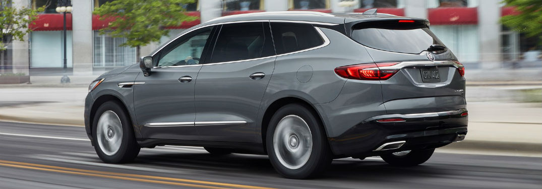 2019 Buick Enclave exterior back fascia and drivers side going fast on road