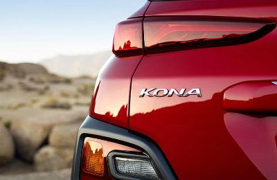 2020 Hyundai Kona red exterior close up shot of driver side rear Kona badging