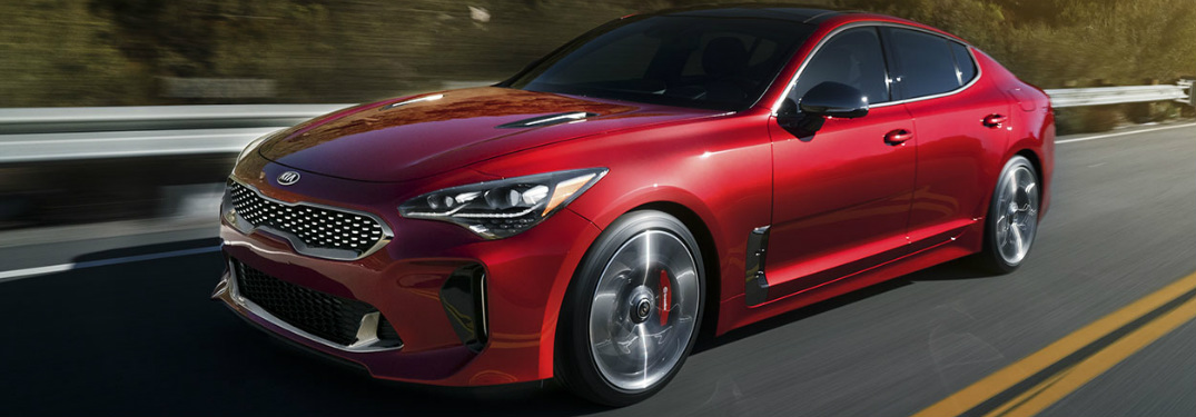 2018 Kia Stinger exterior in red driving down the highway